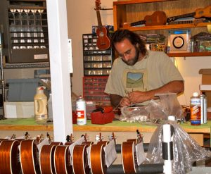 Hoosier Hiver prepares ukes for shipping around the world.